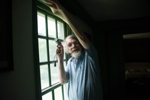 Preservationist Bill Rose Showing One of the Places Where He Obtained a Color Sample